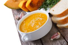 Hot pumpkin soup with sesame seeds on a table Stock Photography