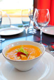 Hot pumpkin soup on table Stock Photos