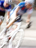Hot Pursuit. Abstract blur of two male professional cyclists competing in a race royalty free stock image