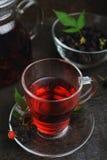 Hot raspberry tea and black raspberries in glass bowl Royalty Free Stock Photo