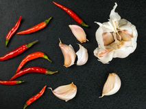 Hot Red Birds Eye Chilli and Fresh Garlic Bulbs Royalty Free Stock Photo