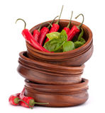 Hot red chili or chilli pepper in wooden bowls stack Royalty Free Stock Image
