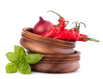 Hot red chili or chilli pepper in wooden bowls stack Stock Image