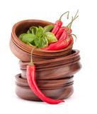 Hot red chili or chilli pepper in wooden bowls stack Stock Photography