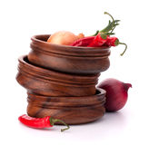 Hot red chili or chilli pepper in wooden bowls stack. Isolated on white background cutout Stock Photos