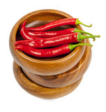 Hot red chili or chilli pepper in wooden bowls stack Royalty Free Stock Images