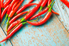Hot red chili pepper  on a old blue color wooden table with plac Stock Images