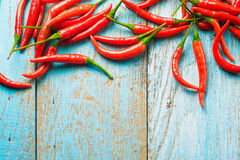 Hot red chili pepper  on a old blue color wooden table with plac Royalty Free Stock Images