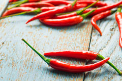 Hot red chili pepper  on a old blue color wooden table with plac Stock Image