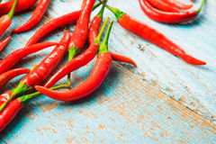 Hot red chili pepper  on a old blue color wooden table with plac Royalty Free Stock Photos