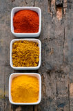 Hot red chili powder, curry and turmeric powder Stock Images