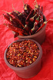 Hot Red Chilli Chillies and crushed pepper Royalty Free Stock Image