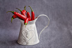 Hot red chilli pepper in a metal gray basket Royalty Free Stock Image