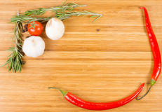 Hot chilli peppers, garlic and rosemary Stock Photos