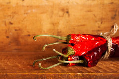 Hot red chillies paper bunch inside wooden case Royalty Free Stock Images