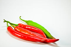 Hot red, green chili peppers Royalty Free Stock Photos