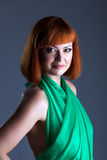 Hot red-haired model posing in green dress Stock Photo