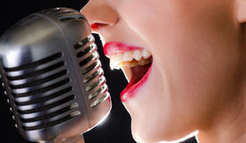 Hot red lips and a silver retro microphone Royalty Free Stock Photo