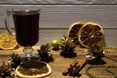 Mulled wine with dried slices of orange. Christmas background. stock image