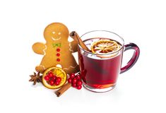 Hot red mulled wine with gingerbread cookie isolated on white background with christmas spices, orange slice, anise and cinnamon royalty free stock photography