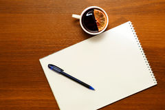 Hot red mulled wine with notepad Royalty Free Stock Photo