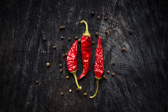 Hot red pepper and black pepper Royalty Free Stock Photo