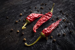 Hot red pepper and black pepper Stock Images
