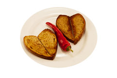 Hot red pepper and two heart toast Royalty Free Stock Photos
