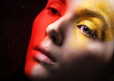 Hot red, sunny yellow, fancy makeup Stock Image