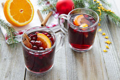 Hot red wine with cranberries and cinnamon Stock Images