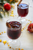 Hot red wine with cranberries and orange Royalty Free Stock Images