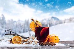 Hot red wine drink on wooden table Royalty Free Stock Photo