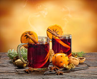 Hot red wine drinks on wooden table Stock Image