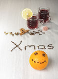 Hot red wine and funny orange with smile Stock Photo