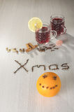 Hot red wine and funny orange with smile Royalty Free Stock Photos