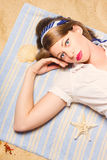 Hot retro pinup girl lying on beach in Australia Royalty Free Stock Photography