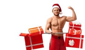 Hot ripped Santa showing his biceps Stock Photos