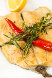 Hot roast fillet fish on plate with chili Stock Photography