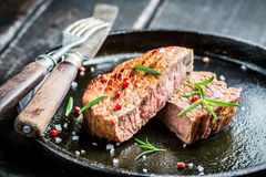 Hot roasted beef with fresh herbs ready to eat Royalty Free Stock Image