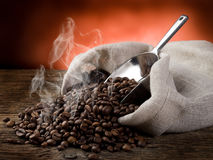 Hot roasted coffee beans. Hot smoking roasted coffee beans stock photo