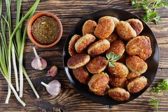 Hot roasted cutlets with garlic sauce Royalty Free Stock Images