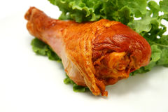 Hot roasted turkey leg served with green lettuce royalty free stock photos