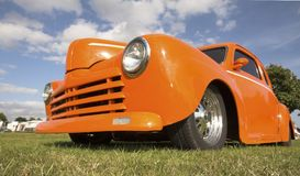 Hot rod. Orange hot rod against a cloudy blue sky stock photo
