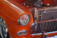 Hot rod. The engine and front of an orange hot rod Stock Images