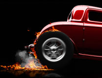 Hot rod burnout on a black background. With room for text or copy space Royalty Free Stock Photography