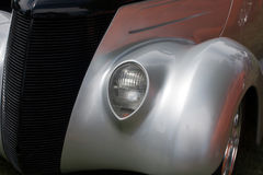 Hot rod car. Front of a classic car with headlight and fender Stock Images