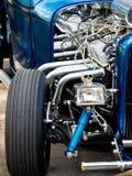 Hot Rod Car. Shiny chrome engine of a customized street rod car with skull decoration Stock Photo