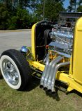 Hot rod car engine. Side view of powerful engine and exhausts of hot rod car or roadster Stock Photos