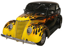 Hot Rod Car with Flames on White Background. Hotrod Antique vehicle with yellow and orange flames isolated on a white background stock photography