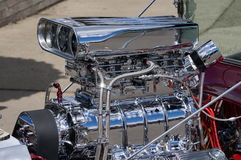 Hot rod engine. This chromed out piece of machinery is ready to burn some rubber Stock Images